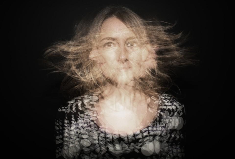 Woman shaking head --- Image by © Elijas van Roon/Corbis