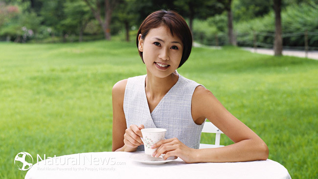 Woman-Tea-Table-Coffee-Outside-Asian-650X