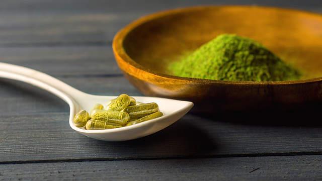 Mitragynina Speciosa Or Kratom Powder In Wooden Bowl And Kratom